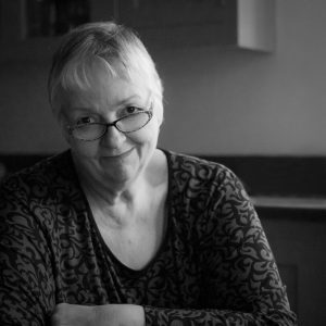 black and white image of smiling mature woman headshot photogrpahy by alison read
