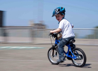 using panning technique to show child on speeding bike