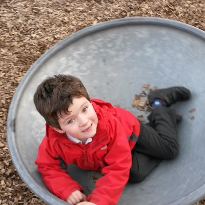 child spinning on a circular panning technique shot