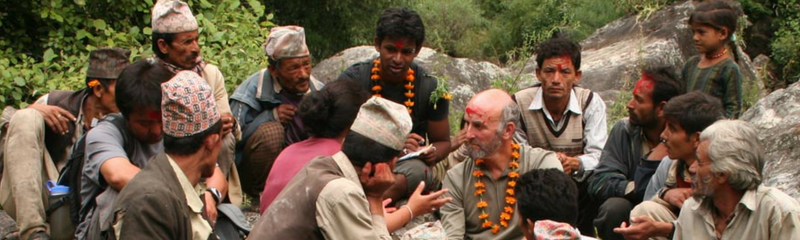 Header image of business man on a rock in Nepal engaging customers