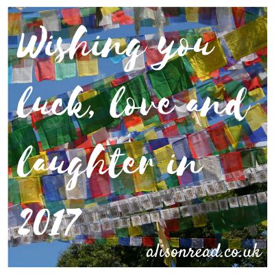 happy new year - buddhist prayer flags on a simple graphic by alison read
